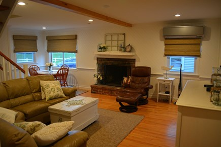 Yarmouth Cape Cod vacation rental - Living Room with Dining Table and Fireplace and Central AC