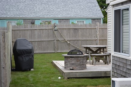 Yarmouth Cape Cod vacation rental - Backyard deck with Weber Grill and outdoor Firepit!