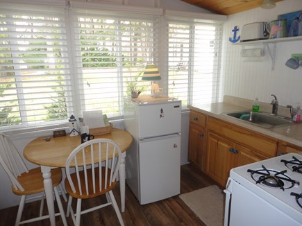Wellfleet Cape Cod vacation rental - Kitchen- eating area in sunroom