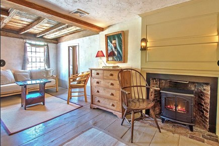 Plymouth Cultural District MA vacation rental - Upstairs gathering room w TV, fireplace, original beams