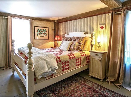 Plymouth Cultural District MA vacation rental - 330 year old king posts in corners this Queen bedroom