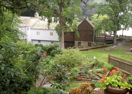 Plymouth Cultural District MA vacation rental - View of back of Grist Mill with water wheel, paths along stream