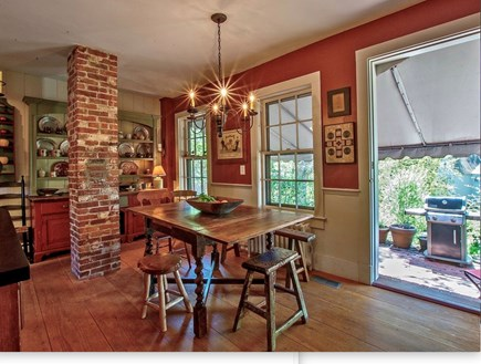 Plymouth Cultural District MA vacation rental - Delightful kitchen w brick patio, gas grill and WATERFALL