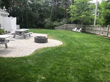 Dennis Port Cape Cod vacation rental - Back yard w/shower, fire pit, plenty of seating and room to play!