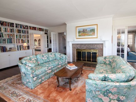 West Falmouth Cape Cod vacation rental - Living room with bookcase library
