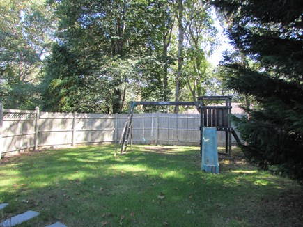West Falmouth Cape Cod vacation rental - Fenced in backyard with swing set