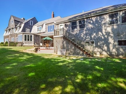 West Falmouth Cape Cod vacation rental - Back of Home with deck areas  showing Addition with entrance