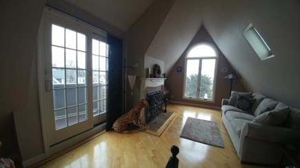 Provincetown, West End Cape Cod vacation rental - Upper Living room with fireplace and views....