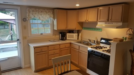 Harwichport, Red River Beach Cape Cod vacation rental - Kitchen with stove, microwave, coffee pot, and kitchen essentials
