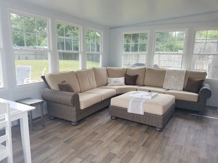Harwich Port, Red River Beach Cape Cod vacation rental - Sun room with couch, table and tv