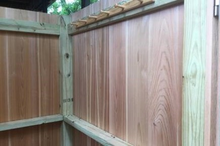 Provincetown, West End Cape Cod vacation rental - Ground level cedar outdoor shower with hanging rack.