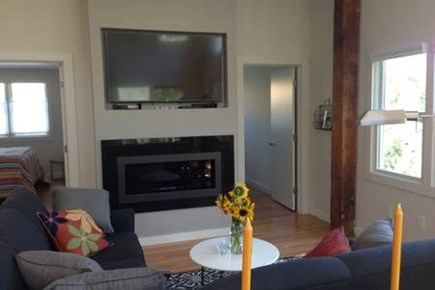 Provincetown, West End Cape Cod vacation rental - Large flat screen TV above modern gas fireplace.