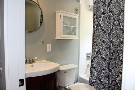 In The Heart of Brewster Cape Cod vacation rental - 2nd floor bath with a full size tub and shower.