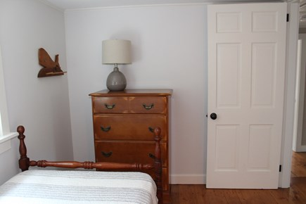 In The Heart of Brewster Cape Cod vacation rental - Two Twin beds with a dresser.