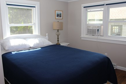In The Heart of Brewster Cape Cod vacation rental - First floor Queen Bed with dresser and nightstand