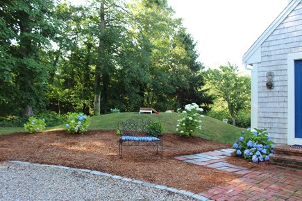 In The Heart of Brewster Cape Cod vacation rental - The backyard is perfect for a game of corn hole and relaxation.