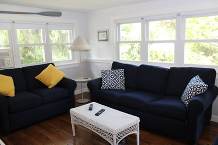 In The Heart of Brewster Cape Cod vacation rental - Family gathering and queen sleeper and a large flat screen tv.