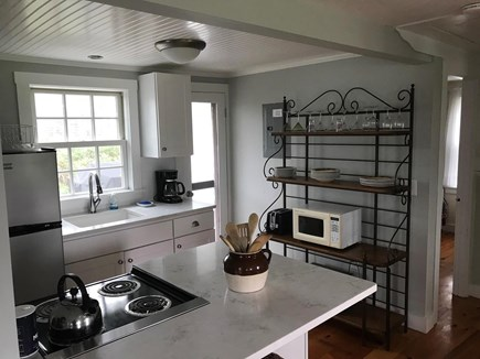 North truro Cape Cod vacation rental - Updated kitchen area with door to back patio