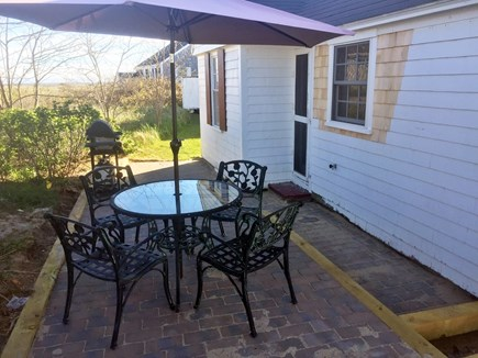 North truro Cape Cod vacation rental - Outside patio with new barbecue grill and seating for four
