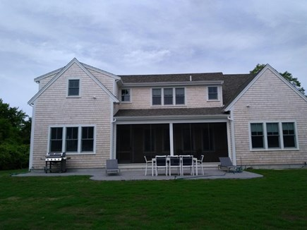 Yarmouthport Cape Cod vacation rental - Rear view with patio seating for 8, BBQ, screened porch