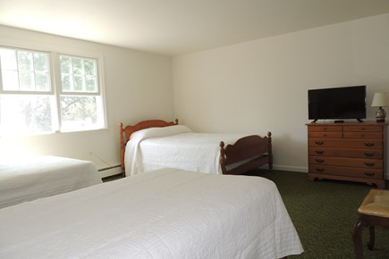 Harwich Port Cape Cod vacation rental - Second floor bedroom with 1 full & two twin beds