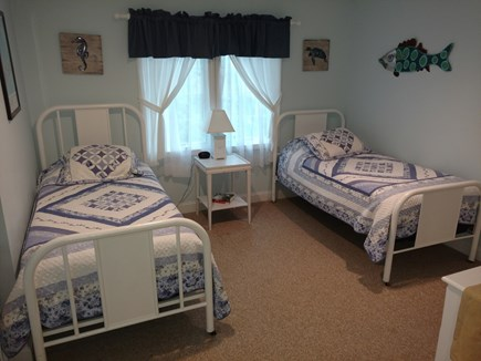 Hyannis, Barnstable Cape Cod vacation rental - Second floor bedroom with two twin beds, and a full bed.