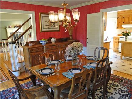 Brewster Cape Cod vacation rental - Large dining room with elegant furniture looks out to side yard