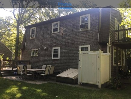 Falmouth, Teaticket Cape Cod vacation rental - Back yard with table with 8 chairs & High top table with 3 Chairs