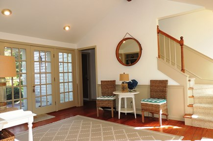 South Chatham Cape Cod vacation rental - Foyer with french wooden doors leading to back yard