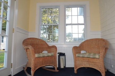 Harwich Port Cape Cod vacation rental - Porch area leading to patio & back yard