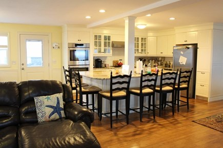 West Dennis Cape Cod vacation rental - Downstairs open kitchen & dining area adjacent to the living room