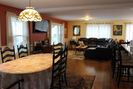 West Dennis Cape Cod vacation rental - Downstairs open dining & living area w/panoramic water views