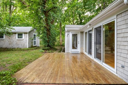 Brewster Cape Cod vacation rental - View of the back yard, back door, and the couples cottage