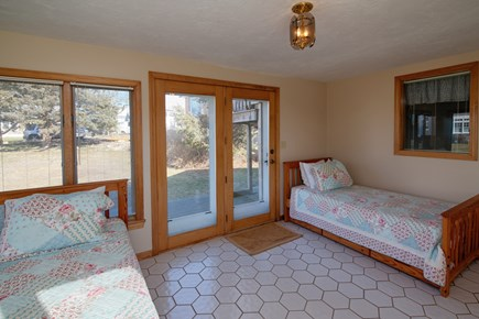 North Falmouth Cape Cod vacation rental - Sun Room with 2 twin beds that have trundles. No privacy door