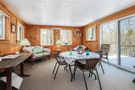 Falmouth, Old Silver Beach Cape Cod vacation rental - Sun Room off of the dining room.  Perfect spot to enjoy a coffee.