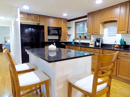 North Falmouth Cape Cod vacation rental - Breakfast bar in kitchen with granite counter tops