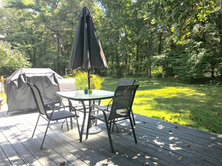North Falmouth Cape Cod vacation rental - 1 of 2 rear decks, sofa and teak dining table-NEW for '21 :)