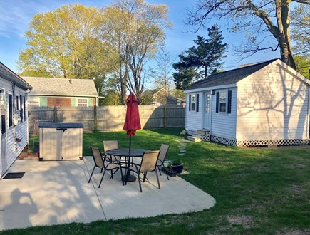 Plymouth, Priscilla Beach MA vacation rental - Backyard and large cement patio, fully fenced in.