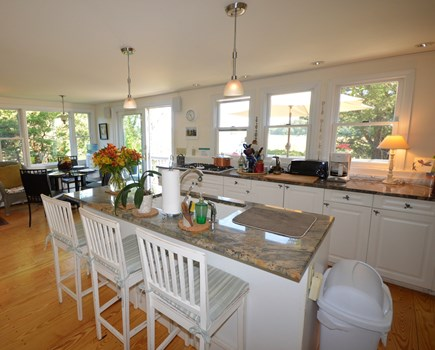Eastham Cape Cod vacation rental - Large kitchen with seating island and view of marsh