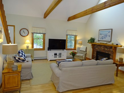 Eastham Cape Cod vacation rental - Vaulted living room with skylights and TV