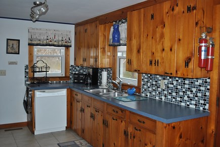 Eastham  Cape Cod vacation rental - Classic knotty pine kitchen with updated features