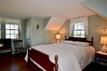 Orleans Cape Cod vacation rental - Upper level queen bedroom with TV and peeks of ocean
