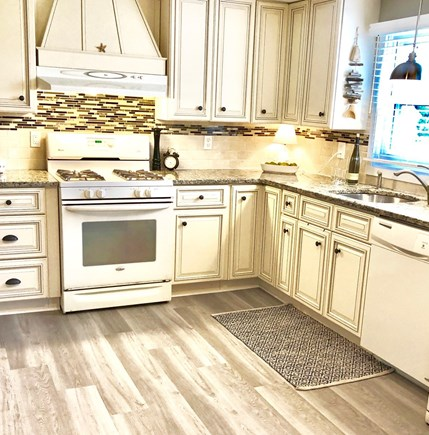 West Yarmouth Cape Cod vacation rental - Kitchen with Granite counter top, dishwasher, and gas stove