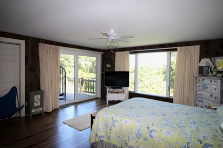 Truro Cape Cod vacation rental - First floor bedroom suite with queen bed opens to main deck