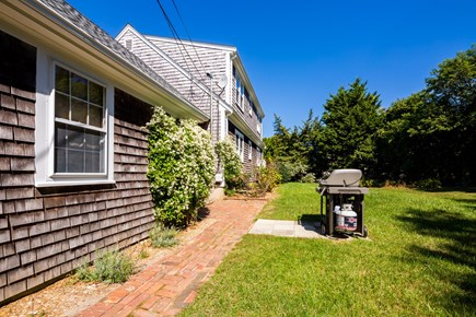 Orleans Cape Cod vacation rental - Backyard with grill and spacious lawn for kids to play