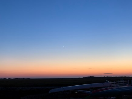North Truro Cape Cod vacation rental - Roof deck sunset.