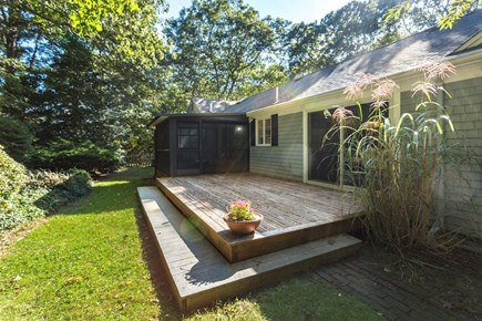 East Sandwich Cape Cod vacation rental - Cook dinner on the large deck and enjoy it on the screened porch