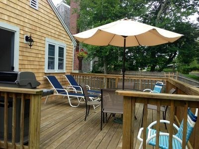 West Harwich Cape Cod vacation rental - Porch over looking large back yard with two lounge chairs.