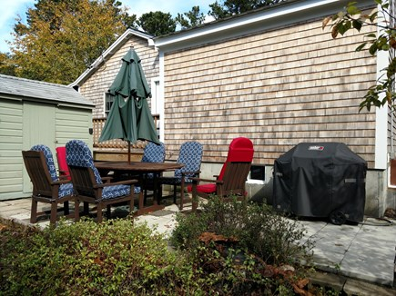 East Harwich Lond Pond Cape Cod vacation rental - Back patio with table, chairs and grill