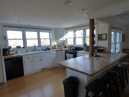 Dennis, East Dennnis Cape Cod vacation rental - Kitchen open to living room and dining room.